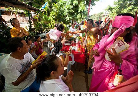 KO CHANG, THAILAND - NOV 10: Unidentified participant at Chang Buddha festival, Nov 10, 2012 on Chang island, Thailand. According to the last census 94 % of Thais are Buddhists of Theravada tradition.