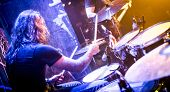 foto of drum-kit  - musician playing drums on stage - JPG