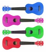 stock photo of ukulele  - Toy Miniature Ukuleles on Isolated White Background - JPG
