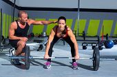 stock photo of concentration man  - gym personal trainer man with weight lifting bar woman workout in exercise - JPG
