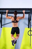 stock photo of rope pulling  - toes to bar woman pull - JPG