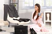 stock photo of pyjama  - Sleepy businesswoman getting ready for work in morning - JPG