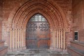 Ancient Church Door With Sandstone Arch poster