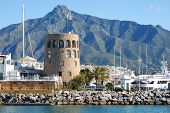 foto of sea-scape  - Harbour entrance with the watchtower to the left and La Concha mountain to the rear Puerto Banus Marbella Costa del Sol Malaga Province Andalucia Spain Western Europe - JPG