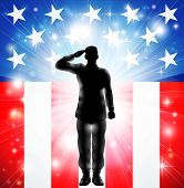 stock photo of patriot  - A US military armed forces soldier in silhouette saluting in front of an American flag background - JPG