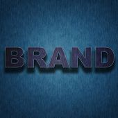 Brand concept -  letters on dark blue vintage fabric background poster