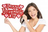 Valentines day. Woman showing holding sign excited with the text VALENTINES DAY.  Lovely happy multi