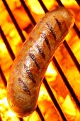 picture of grilled sausage  - Delicious sausage cooking over a hot barbecue grill - JPG