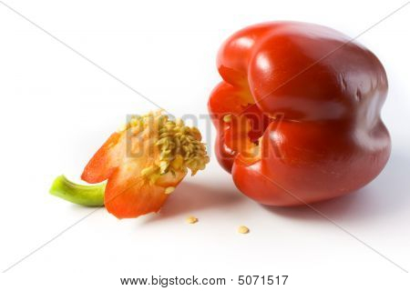 Red Pepper And Its Cut Out Core With Seeds.
