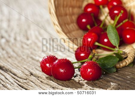 Some Cherries In A Small Basket