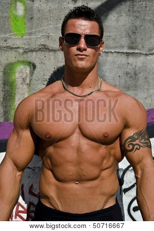 Attractive Young Muscle Man On Graffiti Wall