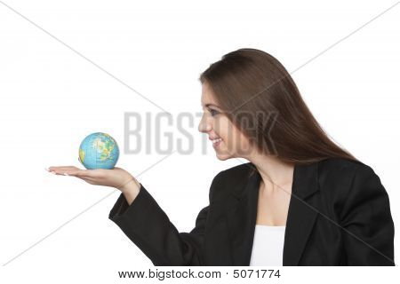 Business Woman Looking At The Earth In Her Hand