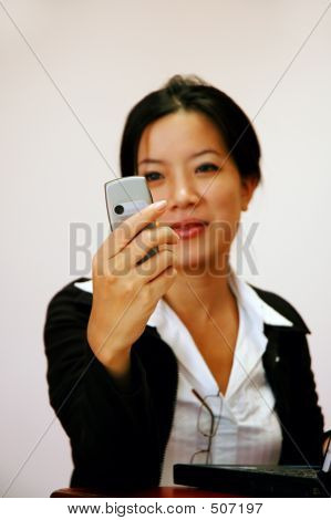 Woman Worker Checking Her Phone