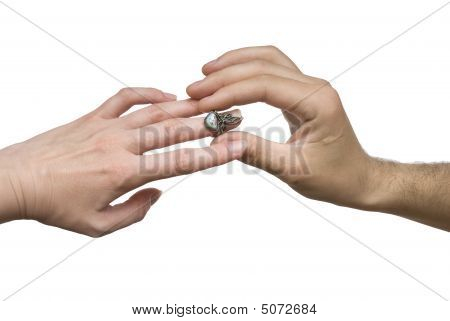 Man And Woman Hands With An Old Ring