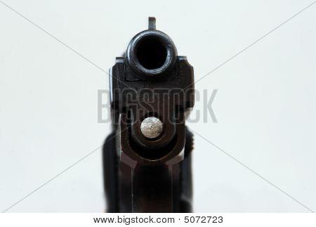 Looking Into Barrel Of Pistol