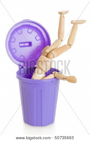 Wooden Mannequin Doll Upside Down In Purple Dustbin, Isolated
