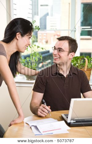 Couple Paying Bills By Online Banking