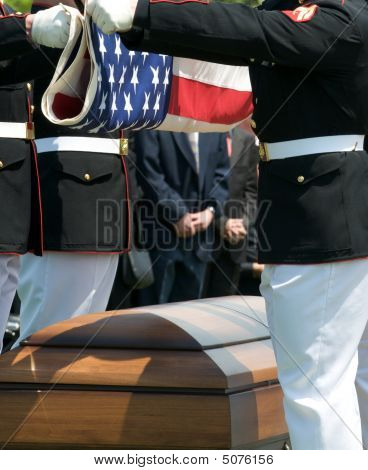 Honor Guard Folding Flag Over Casket