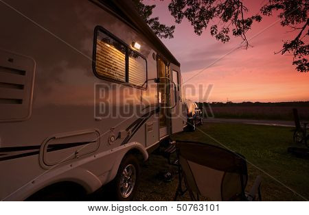 Travel Trailer In Sunset