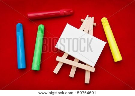 Coloured Pens Beside Easel