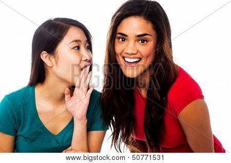 Two Young Girls Gossiping