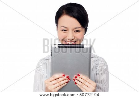 Shy Pretty Corporate Lady Holding Tablet Device