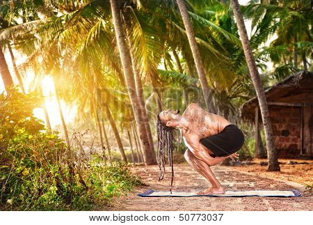 Man With Dreadlocks Doing Yoga