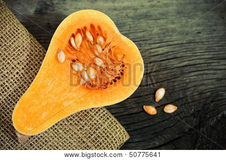 Pumpkin On The Rustic Wooden Background