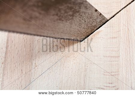 Wood Board Is Cut With Hacksaw