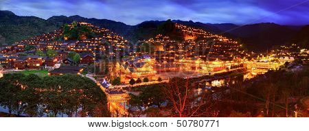 Night View Of The Large Ethnic Village In Southwest China.