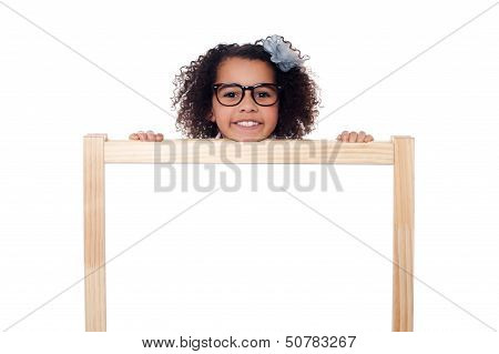 Girl Peeping From Behind White Writing Board