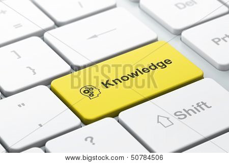 Education concept: Head With Gears and Knowledge on computer key