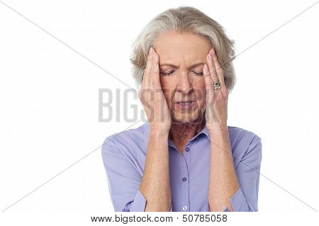 Old Lady Suffering From Headache