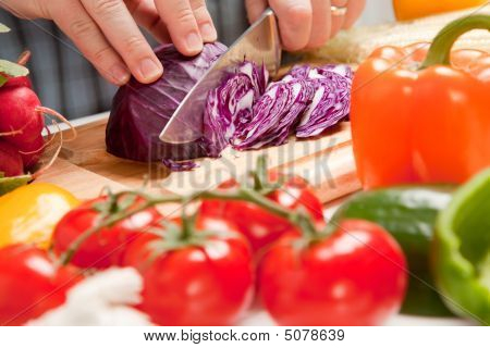 Man Slicing Vegetables