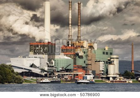 Large Power Plant And Smoky Looking Sky