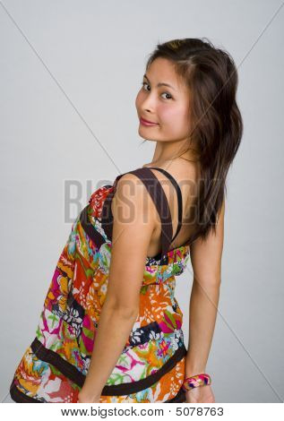 Asian Woman Looking Back Over Her Shoulder