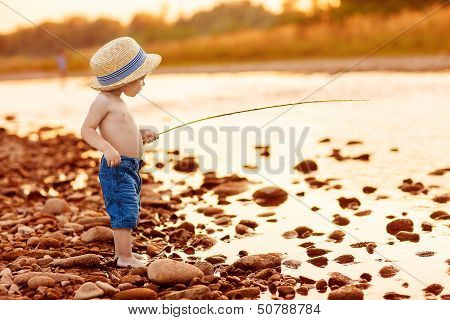 Adorable Baby On River With Fishing-rod And Fishing