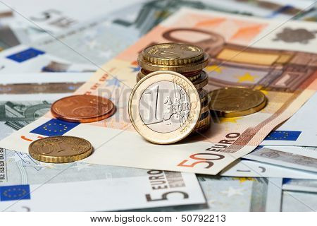 some banknotes on five euros and coins