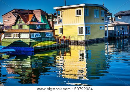Floating Home Village Yellow Brown Houseboats Fisherman's Wharf Reflection Inner Harbor, Victoria Va