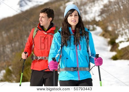 Couple Hiking In Winter Mountain