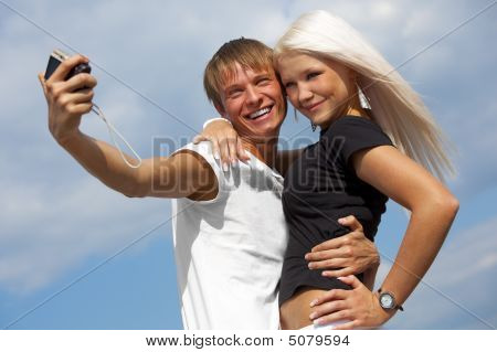 Happy Couple Is Taking A Picture