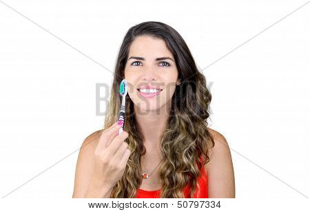 Beautiful Young Woman Showing Toothbrush And Smiling