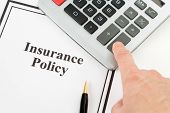 picture of insurance-policy  - Document of Insurance Policy and calculator for background - JPG