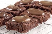 image of brownie  - sweet brownie baked with chocolate on a cooling rack - JPG
