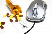 stock photo of prescription pad  - Computer mouse and pills placed on a prescription pad - JPG