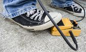 picture of pedal  - yellow guitar pedal with grunge jeans and trainers - JPG