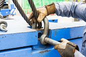 image of shackles  - Close up worker fitting bolt anchor shackle with wire rope sling on crane counter weight - JPG