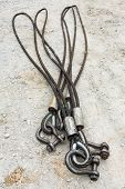 picture of shackles  - Heavy duty steel wire rope sling with safety anchor shackle bolt in construction site - JPG