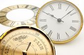 stock photo of barometer  - Clock and barometer dials or bezels focus on barometer face