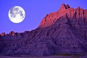 stock photo of butt  - Full Moon in the Badlands National Park South Dakota USA - JPG
